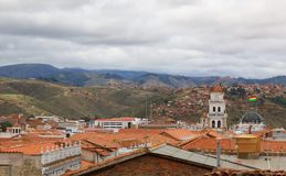 Skyline over Sucre, bolivia. Aerial view over the capital city. Bolivia waving flag royalty free stock photo