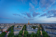 Skyline of Paris with Champs-Elysees and Eiffel tower at sunset Royalty Free Stock Image