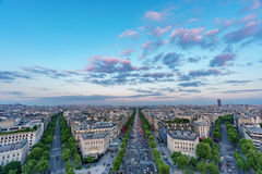 Skyline of Paris with Champs-Elysees and Sacre coeur at sunset Stock Image
