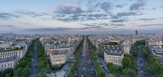Skyline of Paris with Champs-Elysees at sunset Stock Photos