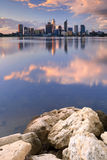 Skyline of Perth, Australia across the Swan River at sunset Stock Photos