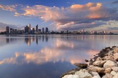 Skyline of Perth, Australia across the Swan River at sunset Royalty Free Stock Images