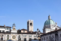 Skyline of Piazza della Loggia in Brescia with the dome of the C Royalty Free Stock Image