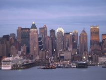 Skyline and Pier. This is a view of the New York City skyline and pier in the early evening stock images
