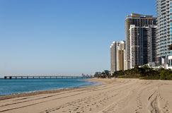Skyline and pier along the beach of Sunny Isles Beach, Florida Stock Photography