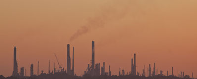 The skyline of pollution from industry. An industrious skyline showing polluton from large chimney stacks royalty free stock images