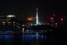 Skyline of Pyongyang at night. The photo shows a part of the skyline of Pyongyang with its Tower of Juche idea, the May Day Stadium and the Taedong river Royalty Free Stock Image