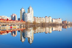 Skyline and reflection. Kiev skyline and reflection on the river Dnipro Stock Photos