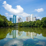 Skyline and reflections of midtown Atlanta, Georgia. In Lake Meer from Piedmont Park Stock Photo