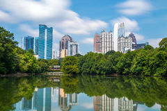 Skyline and reflections of midtown Atlanta, Georgia. In Lake Meer from Piedmont Park Stock Images