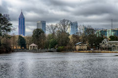 Skyline and reflections of midtown Atlanta, Georgia in Lake Meer from Piedmont Park. stock photography