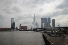 Skyline of Rotterdam with buildings at the Erasmusbrug over river Nieuwe maas. stock photo