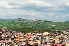 Skyline of a rural town in Sicily. Called Palagonia, with hills in the background Royalty Free Stock Image