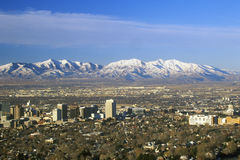 Skyline of Salt Lake City, UT with Snow capped Wasatch Mountains in background stock photos