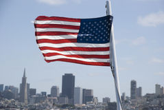 Skyline of San Francisco with American Flag, California Royalty Free Stock Images