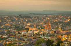 Skyline of San Miguel de Allende in Mexico After Sunset. Illuminated skyline of San Miguel de Allende in Mexico after sunset, with a yellow filter effect stock images