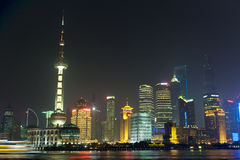 Skyline of Shanghai in clouds by night. Shanghai, China - circa September 2015: Skyline of Shanghai in clouds by night Stock Photos