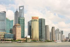 Skyline of Shanghai and tourist boat Stock Images