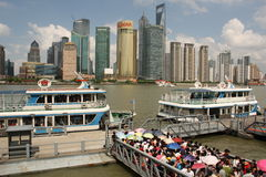 Skyline of Shanghai and tourist boats Stock Image