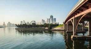 Skyline of Sharjah City, United Arab Emirates. Bridge, park and a skyline of Sharjah City, United Arab Emirates Stock Images
