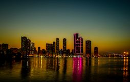 skyline in Sharjah at the moment of sunset stock photography