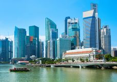 Skyline Singapore financial district view. Skyline of Singapore with financial district view and tour boat by embankment royalty free stock image