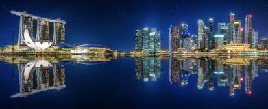 The skyline of Singapore by night stock photo