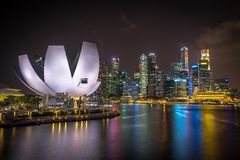 Skyline of Singapore at night stock photography