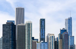 Skyline and sky. Chicago, USA - May 24, 2014: Part of the Chicago skyline including the Aon center with blue sky Stock Photos