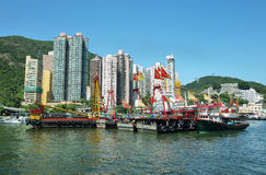 Skyline of the skyscrapers and fishing boats in Aberdeen pier of Hong Kong Royalty Free Stock Photo