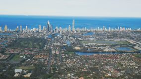 Skyline of Surfers Paradise and beach from helicopter, Gold Coast stock video footage