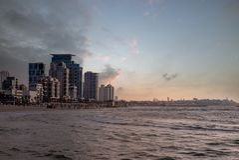 Skyline of Tel Aviv, Israel by the beach at dusk stock image