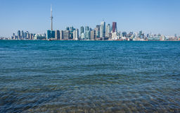Skyline of Toronto seen from the Islands with lake Ontario royalty free stock images