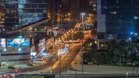 Skyline and traffic on crossroad night timelapse in Kuwait City downtown illuminated at dusk. Kuwait City, Middle East stock footage