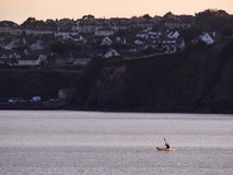 Skyline of Tramore, Ireland, with a canoe in the foreground. The skyline of the beach resort Tramore, Ireland, against an evening sky Stock Photos