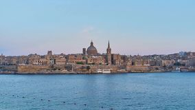 The skyline of Valletta, Malta. Sliema seaside promenade opens a view on ships and boats, medieval Valletta skyline with tall bell tower of St Paul`s Anglican stock video footage