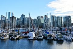 Stanley Park Marina with Vancouver skyline Stock Photo
