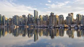 Skyline of Vancouver, BC, Canada from harbor at sunset royalty free stock image