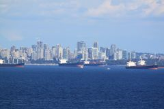 Ships and skyline of Vancouver. Skyline of Vancouver, BC  with ships taken from cruise ship Royalty Free Stock Image