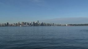 Skyline Vancouver, British Columbia, Canada with take off waterplane stock video footage