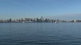 Skyline Vancouver, British Columbia, Canada zoom-out from ferry stock footage