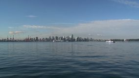 Skyline Vancouver with ferry passing by stock footage
