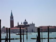 Skyline of venice with Gondola boats and part of the lagoon royalty free stock photography
