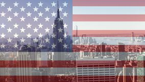 Skyline video. City skyline with skycrapers against animated american flag background stock video