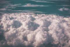 Skyline view above clouds from air plane window Stock Photos