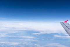 Skyline View above the Clouds from airplane Royalty Free Stock Photo