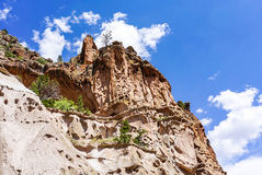 The Canyons and Alcove House at Bandelier National Monument Park in Los Alamos, New Mexico. A skyline view of the Alcove House and the canyons at Bandelier Stock Photography
