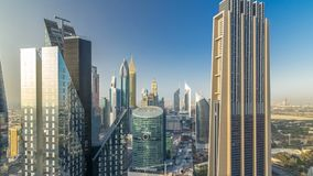 Skyline view of the buildings of Sheikh Zayed Road and DIFC timelapse in Dubai, UAE. Skyscrapers in financial centre aerial view from above before sunset stock video footage