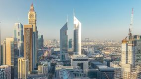 Skyline view of the buildings of Sheikh Zayed Road and DIFC timelapse in Dubai, UAE. Skyscrapers in financial centre aerial view from above before sunset stock video