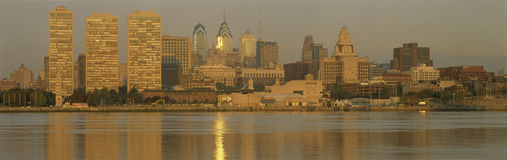 This is the skyline view from Camden, New Jersey. It shows sunrise on the river. Stock Image